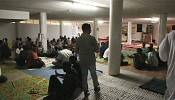 Migrants and refugees celebrate Muslim holiday in an abandoned building in Rome