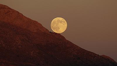 Supermoon rises in the mountains of southern Spain