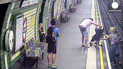 Watch: child rescued from London track 'seconds before train arrives'