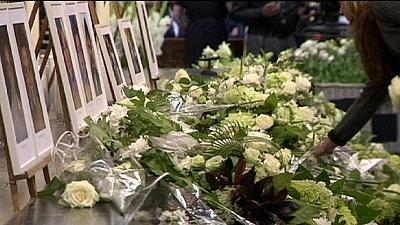 Netherlands holds ceremonies for MH17 victims a month after crash