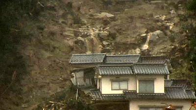 Japan braces for more rain, counts cost of landslides
