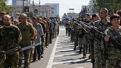 Captured Ukrainian soldiers marched through streets of Donetsk