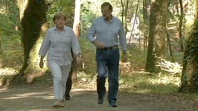 Merkel and Rajoy stretch their legs along historic pilgrim route