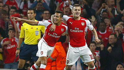 Sanchez sends Arsenal through to Champions League