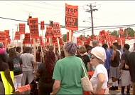 Residents of Ferguson march for justice three weeks after fatal police shooting of Michael Brown