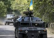 Ukraine troops quit Luhansk airport, accusing Russia of turning tide of war