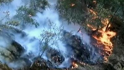 Weather conditions help slow spread of California forest fires