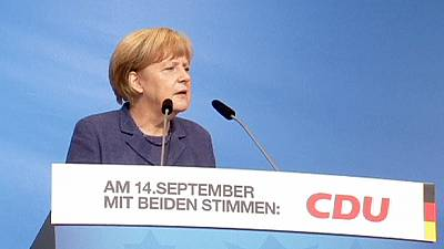 Chancellor Merkel fires warning shot to coalition partners over local union talks.