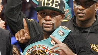 Boxing: Mayweather continues his unbeaten run