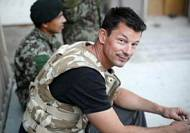 Third British hostage paraded by Islamic State militants