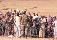 Thousands of Syrians seek refuge from ISIL in Turkey