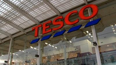 Tesco stuns market by suspending officials, slashes first-half profit