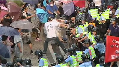 Clashes at Hong Kong pro-democracy protest, leader promises more talks
