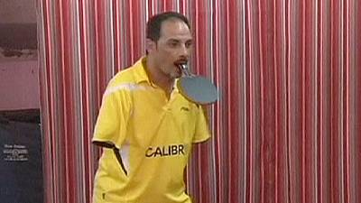 Meet the armless ping-pong champion who says 'nothing is impossible' – nocomment