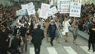 Lagerfeld stages faux street protest for Paris fashion show