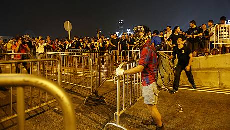 Pro-democracy protesters in Hong Kong threaten to occupy government buildings