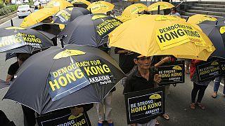 Hong Kong sous les parapluies