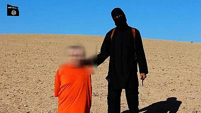 ISIL video 'shows execution' of UK aid worker Alan Henning