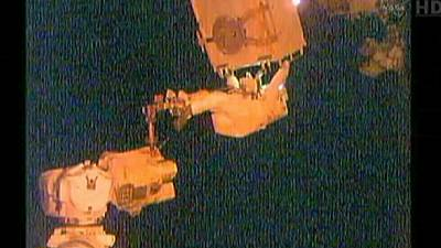 Space walk debut for ISS astronauts