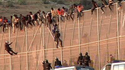 Spanish police again face wave of African migrants climbing fence into Melilla