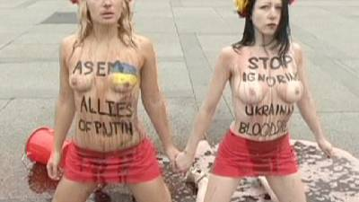 Topless Femen protest Putin's presence at Asia-Europe Meeting – nocomment