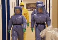 US tightens Ebola procedures for health workers