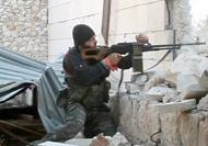 Free Syrian Army rebels battle Syrian regime forces