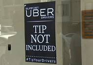 Uber under fire from its own drivers over fare cuts