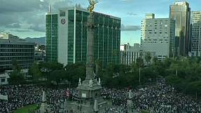 Thousands gather in Mexico City demanding justice for missing students