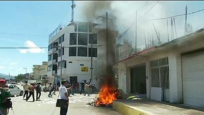 Missing Mexican students' protest turns violent as families call for meet with Pena Nieto