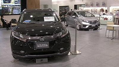 Plagued by recalls, Honda cuts sales forecast