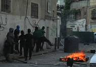 Israeli security and Palestinians clash in East Jerusalem