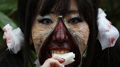 Gruesome costumes for spooky Halloween parade in Japan