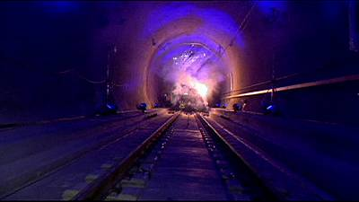 Celebrations as last piece of track is laid in record-breaking Gotthard rail tunnel
