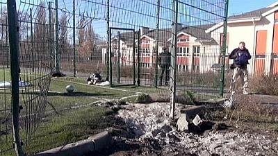 Mourning in East Ukraine for two schoolboys killed as they played football