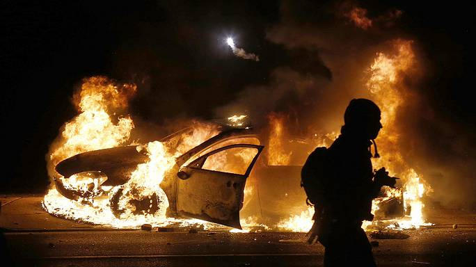 Violence erupts in Ferguson after grand jury shooting decision