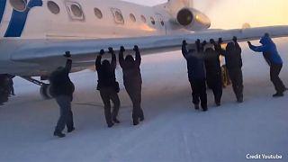 Watch: Passengers 'push-start' frozen plane in Siberia
