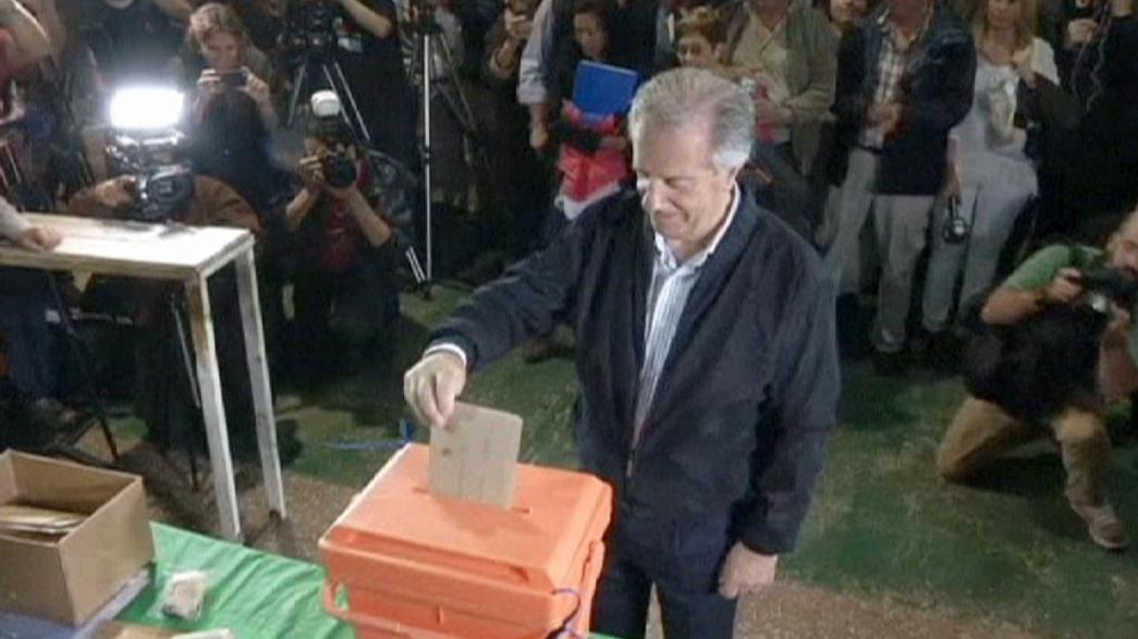 Vazquez wins old job back as Uruguay's president