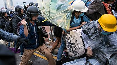 Police and protesters clash at Hong Kong government HQ