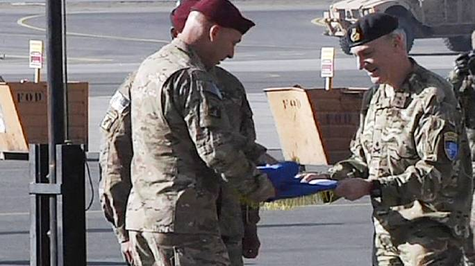 Handover ceremony marks end of US and NATO combat mission in Afghanistan
