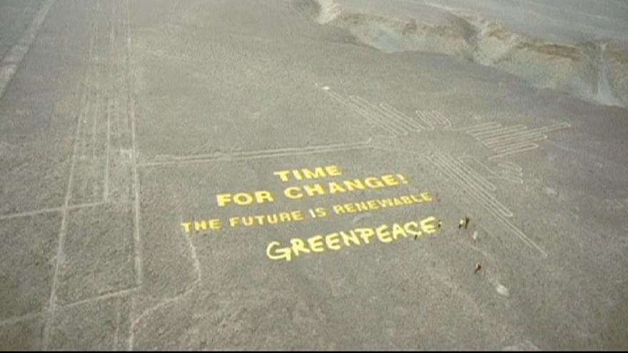 Giant Greenpeace banner beside ancient Nazca Lines