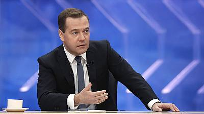 Russia's Medvedev tried to reassure over weakening economy and rouble