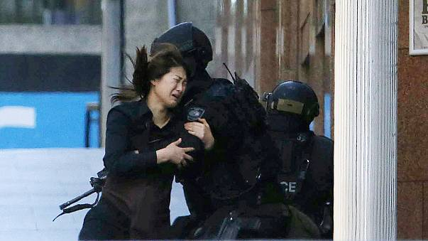 Sydney siege: Five hostages run from cafe