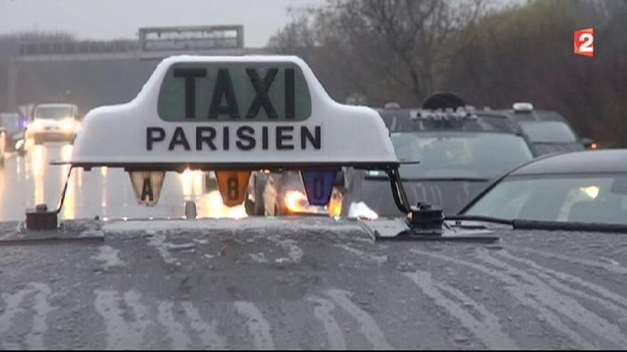 Parts of Paris crawl to a halt as taxi drivers protest against UberPOP