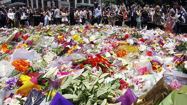 Flags fly at half-mast across Sydney after the violent end to a cafe siege