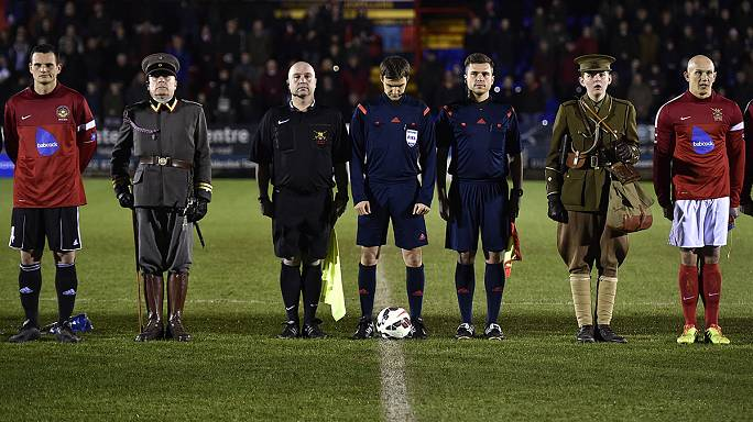 British and German troops hold commemorative football match to mark 1914 Christmas truce