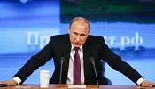 Putin tries to reassure over rouble worries, but also slams the West