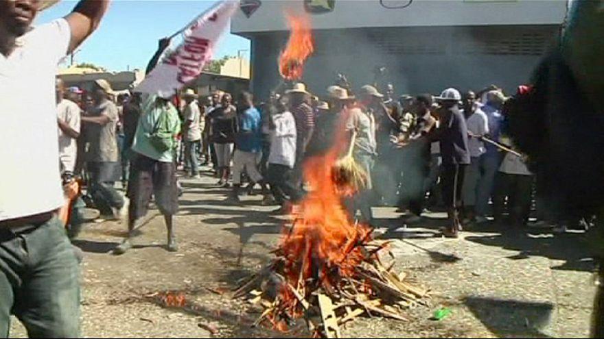 Protesters demand Haiti President Michel Martelly's resignation