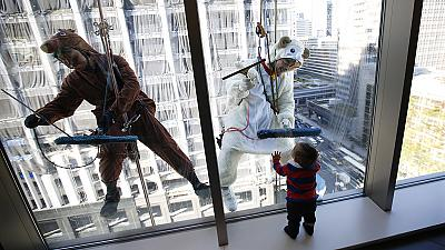 Window cleaners horse around to bleat about Tokyo's festive calendar