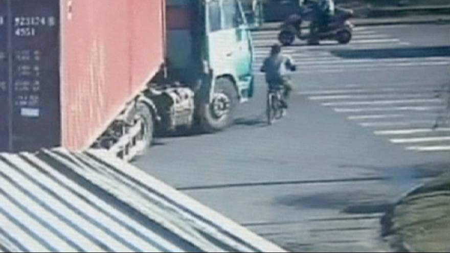 Cyclist's incredible escape after being run over by a lorry